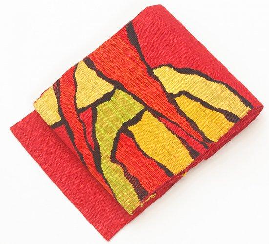 赤地 切り絵風の抽象柄のサムネイル画像