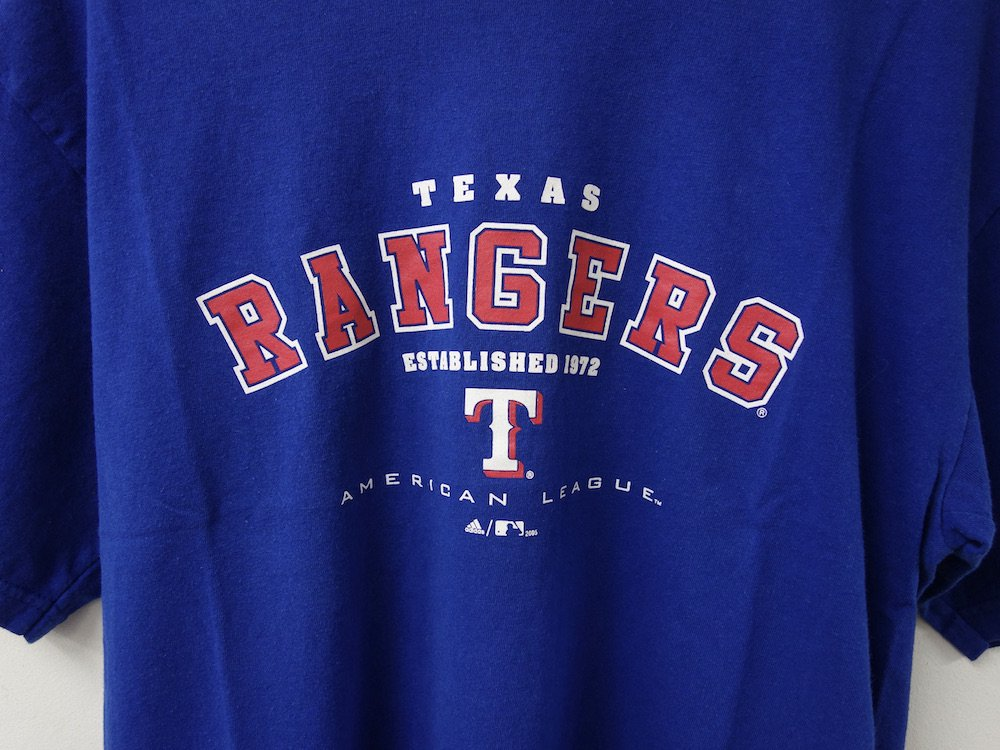 <img class='new_mark_img1' src='https://img.shop-pro.jp/img/new/icons15.gif' style='border:none;display:inline;margin:0px;padding:0px;width:auto;' />adidas Texas Rangers Tシャツ USED