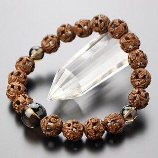 数珠ブレスレット 約10ミリ 柘植 羅漢彫り 茶水晶 107080101 送料無料