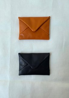 Naturally tanned leather coin case